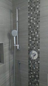 12x24 porcelain tile shower with glass and metal mosaic accent