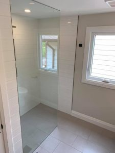 curbless entry shower floor with porcelain tile