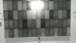 high variation vertically stacked subway tile backsplash