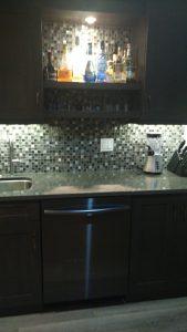 wetbar with metal and glass mosaic backsplash